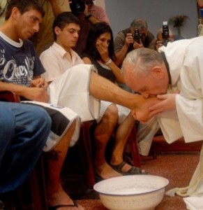 Pope Francis washes and kisses feet of a young offender  Photograph: AFP/Getty